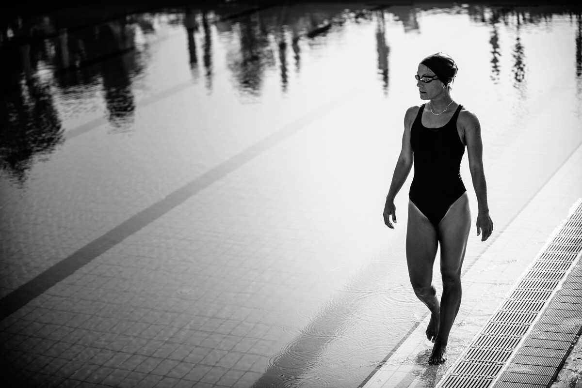 Swimmer walking poolside